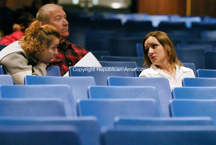 WATERBURY, CT - 12 OCTOBER 2005 -101305JS01 Waterbury  parents Barbara Ferguson, left and Melissa Stevens, right, talk about the state of Waterbury schools as Richard Ferguson, center, listens to a presentation on the school choice process Thursday during a forum at Kennedy High School in Waterbury.     --Jim Shannon / Republican-American--Barbara Ferguson; Melissa Stevens; Richard Ferguson, Kennedy High School,  Waterbury are CQ