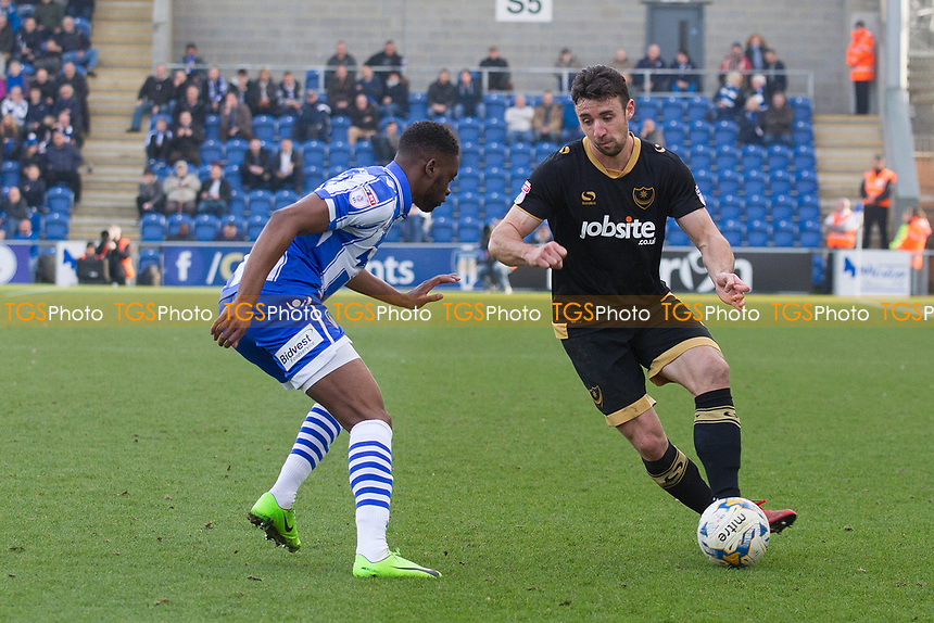 Enda Stevens of Portsmouth plays the ball behind Kane Vincent-Young of Colchester United during Colchester United vs Portsmouth, Sky Bet EFL League 2 Football at the Weston Homes Community Stadium on 11th March 2017