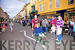 Look out!!!! Main Street Cahersiveen was closed to traffic on Friday night last as part of the Culture night and became venue for a wheelbarrow race pictured here finally crossing the line are Breda Moran & Brendan O'Sullivan.