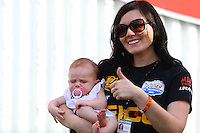 Sept. 1, 2014; Clermont, IN, USA; Stephanie Laski finance of NHRA top fuel dragster driver Richie Crampton with their daughter Emma Crampton celebrates after winning the US Nationals at Lucas Oil Raceway. Mandatory Credit: Mark J. Rebilas-USA TODAY Sports