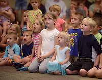 NWA Democrat-Gazette/BEN GOFF @NWABENGOFF<br /> Children watch as Ellen Winters and Galen Harp of Institute of Jugglology from Fayetteville perform on Thursday June 9, 2016 at the Bentonville Public Library. Harp and Winters won the International Jugglers Association team stage juggling world championship in 2014.