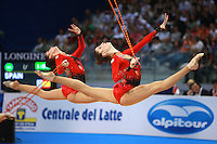 (L-R) Barbara Gonzalez and Veronica Ruiz of Spain perform 5-ropes split leap in unison with Spanish group at 2008 European Championships at Torino, Italy on June 7, 2008.  Photo by Tom Theobald.