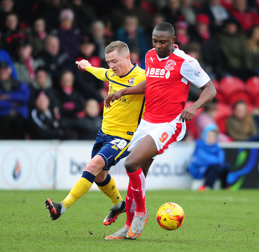 Fleetwood Town&rsquo;s Shola Ameobi shields the ball from Scunthorpe United's Gary McSheffrey<br /> <br /> Photographer Chris Vaughan/CameraSport<br /> <br /> Football - The Football League Sky Bet League One - Fleetwood Town v Scunthorpe United  - Saturday 20th February 2016 - Highbury Stadium - Fleetwood    <br /> <br /> &copy; CameraSport - 43 Linden Ave. Countesthorpe. Leicester. England. LE8 5PG - Tel: +44 (0) 116 277 4147 - admin@camerasport.com - www.camerasport.com