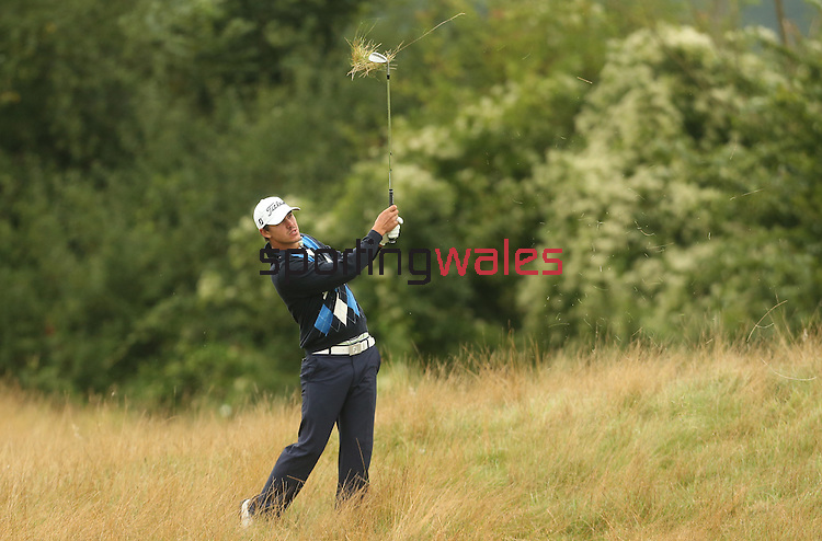 Brooks Koepka plays from the long grass on the 2nd hole during the first round of the ISPS Handa Wales Open 2013 at the Celtic Manor Resort<br /> 29.08.13<br /> <br /> ©Steve Pope-Sportingwales