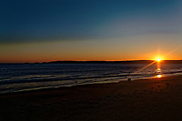 The sun sets over Swansea Bay in south Wales, UK. Sunday 18 November 2018