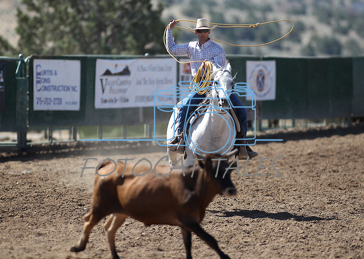 Images from the team roping event at the Minden Ranch Rodeo on Sunday, July 24, 2011, in Gardnerville, Nev. .Photo by Cathleen Allison
