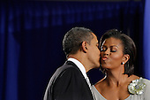 United States President Barack Obama (L) kisses first lady Michelle Obama after delivering remarks before signing the Healthy, Hunger-Free Kids Act of 2010 at Harriet Tubman Elementary School, Monday, December 13, 2010 in Washington, DC. In an effort to provide children with better school lunches and breakfasts, the new law puts $4.5 million in the hands of child nutrition programs, sets nutrition standards on school vending machines, helps create school gardens and makes sure that quality drinking water is available during meal times. .Credit: Chip Somodevilla - Pool via CNP