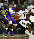 Louisville's Terry Rozier 0) guards Northern Iowa State's Wes Washpun (11)  during the 2015 NCAA Division I Men's Basketball Championship's March 22, 2015 at the Key Arena in Seattle, Washington.  Louisville beat Northern Iowa State 66-53 to advance to the Sweet 16.  ©2015. Jim Bryant Photo. ALL RIGHTS RESERVED.