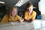 Pupils from Radyr Primary School visititing Welsh Water Education Centre in Cilfynydd..Brooke Harries and Owen Hardly monitoring a dripping tap to calculate water waste..24.05.12.©Steve Pope