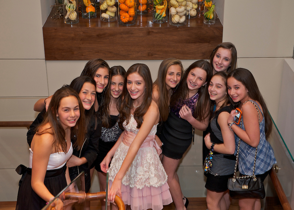The Bat Mitzvah girl posing with her girlfriends on a stairway.