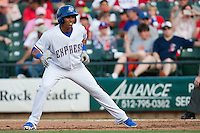Round Rock Express center fielder Leonys Martin #27 leads off first base during the MLB exhibition baseball game against the Texas Rangers on April 2, 2012 at the Dell Diamond in Round Rock, Texas. The Rangers out-slugged the Express 10-8. (Andrew Woolley / Four Seam Images).