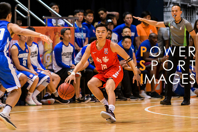 Cheng Ho Hang #18 of SCAA Men's Basketball Team dribbles the ball up court against the Eastern Long Lions during the Hong Kong Basketball League playoff game between Eastern Long Lions and SCAA at Queen Elizabeth Stadium on July 24, 2018 in Hong Kong. Photo by Marcio Rodrigo Machado / Power Sport Images