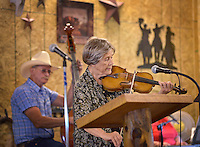 NWA Democrat-Gazette/BEN GOFF &bull; @NWABENGOFF<br /> Celia Wallace of Bella Vista plays fiddle with the worship band on Sunday June 21, 2015 during service at Corner Post Cowboy Church East of Siloam Springs.
