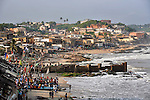 Villagers gather along the beach in the town of Cape Coast, Ghana; a small fishing village on the west coast of Africa.