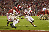 Hawgs Illustrated/BEN GOFF <br /> Chase Hayden, Arkansas running back, evades Alabama linebackers Mack Wilson (30) and Joshua McMillon (40) on a run in the fourth quarter Saturday, Oct. 14, 2017, at Bryant-Denny Stadium in Tuscaloosa, Ala.