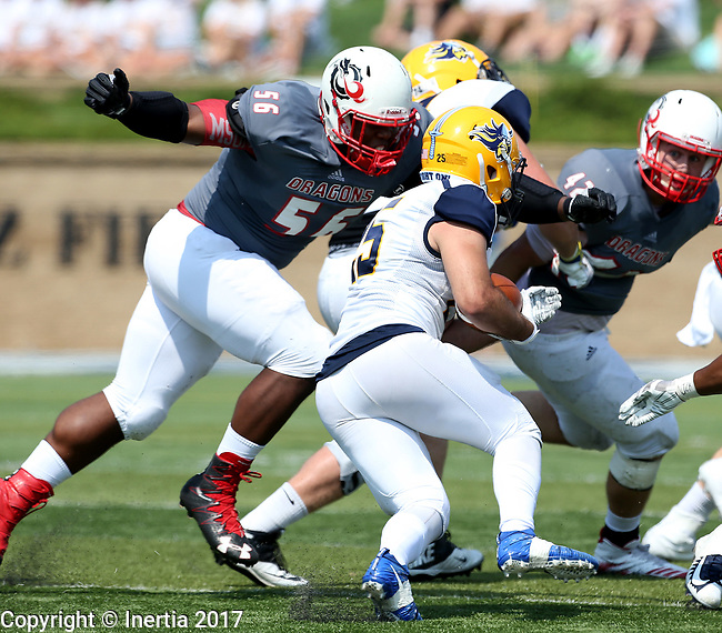 SIOUX FALLS, SD - SEPTEMBER 2: Darin Gipson Jr. #56 from the University of Minnesota Morehead prepares to wrap up Caden Quintanilla #25 from Augustana in the first half of their game Saturday afternoon at Augustana University. (Photo by Dave Eggen/Inertia)
