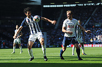 West Bromwich Albion's Ahmed Hegazy vies for possession with Tottenham Hotspur's Harry Kane<br /> <br /> Photographer Ashley Crowden/CameraSport<br /> <br /> The Premier League - West Bromwich Albion v Tottenham Hotspur - Saturday 5th May 2018 - The Hawthorns - West Bromwich<br /> <br /> World Copyright &copy; 2018 CameraSport. All rights reserved. 43 Linden Ave. Countesthorpe. Leicester. England. LE8 5PG - Tel: +44 (0) 116 277 4147 - admin@camerasport.com - www.camerasport.com