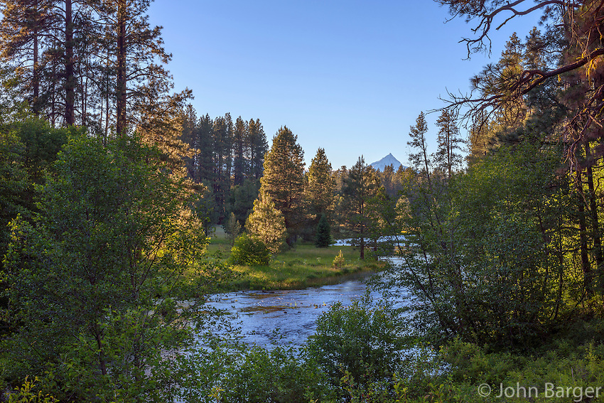 USA, Oregon, Deschutes National Forest, Headwaters of the Metolius River and distant Mount Jefferson at sunset. The Metolius River is a federally designated Wild and Scenic River.