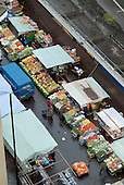 Fruit, vegetables and clothing on sale at Church Street market in Paddington, London
