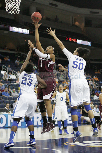 TAMU center Kelsey Bone makes a shot despite UK defense during the second half of the University of Kentucky women's basketball game vs. Texas A&M University during the SEC Tournament Championship Game at The Arena at Gwinnett Center in Duluth, Ga. on Sunday, March 10, 2013. Texas A&M won 75-67. Photo by Genevieve Adams | Staff