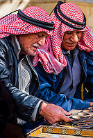Men playing manqala (a game), As-Salt, Jordan.