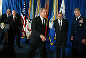 United States President George W. Bush, center, leaves the lectern after making remarks following a classified briefing at the Pentagon May 10, 2004.  Leaving with the Bush are US Secretary of State Colin Powell, left, US Vice President Dick Cheney, 2nd Left, US Secretary of Secretary Donald Rumsfeld, 2nd Right,  and Joint Chief Chairman General Richard Myers, right.  Bush's trip to the Pentagon was scheduled before the Abu Ghraib prisoner abuse scandal made headlines.  <br /> Credit: Mark Wilson / Pool via CNP