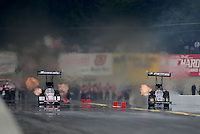 Oct. 6, 2012; Mohnton, PA, USA: NHRA top fuel dragster driver Antron Brown (left) races alongside Dom Lagana during qualifying for the Auto Plus Nationals at Maple Grove Raceway. Mandatory Credit: Mark J. Rebilas-