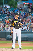 Steven Hensley (11) of the Salt Lake Bees looks to the catcher for the signal against the Oklahoma City Dodgers in Pacific Coast League action at Smith's Ballpark on May 25, 2015 in Salt Lake City, Utah.  (Stephen Smith/Four Seam Images)