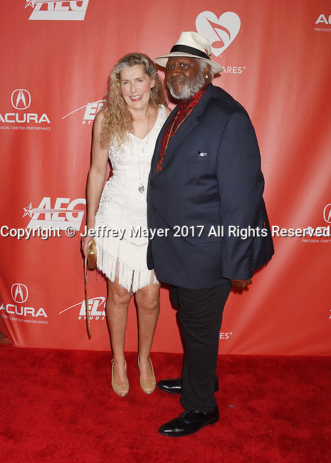 LOS ANGELES, CA - FEBRUARY 10: Musician Taj Mahal (R) and Inshirah Geter attend MusiCares Person of the Year honoring Tom Petty at the Los Angeles Convention Center on February 10, 2017 in Los Angeles, California.