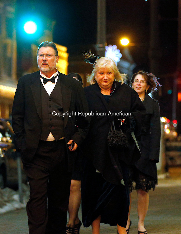 """Torrington, CT- 02 January 2016-010216CM09-  Caleb and Helen Cutler of New Hartford arrive dressed up for a preview of the premier of the PBS drama series """"Downton Abbey"""" at the Warner Theatre in Torrington on Saturday.      Christopher Massa Republican-American"""