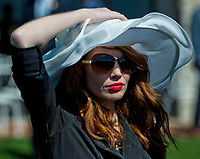 LEXINGTON, KENTUCKY - APRIL 07: A woman holds her hat on her head while watching horses in the paddock on opening day at Keeneland Race Course on April 7, 2017 in Lexington, Kentucky. (Photo by Scott Serio/Eclipse Sportswire/Getty Images)