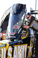Sept. 14, 2012; Concord, NC, USA: NHRA top fuel dragster driver Tony Schumacher sits strapped into his car with a crew member during qualifying for the O'Reilly Auto Parts Nationals at zMax Dragway. Mandatory Credit: Mark J. Rebilas-