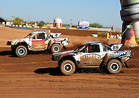 Apr 16, 2011; Surprise, AZ USA; LOORRS driver Jason Ellis (89) races alongside Ron Duncombe (4) during round 3 at Speedworld Off Road Park. Mandatory Credit: Mark J. Rebilas-.