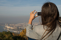 Tourist takes pictures of the foggy autumn view in Budapest, Hungary on Oct. 20, 2017. ATTILA VOLGYI