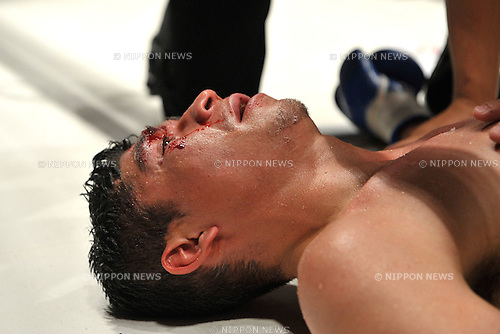 Jorge Solis (MEX),..DECEMBER 31, 2011 - Boxing :..Jorge Solis of Mexico lies on the ring after being knocked out in the eleventh round during the WBA super featherweight title bout at Yokohama Cultural Gymnasium in Kanagawa, Japan. (Photo by Hiroaki Yamaguchi/AFLO)