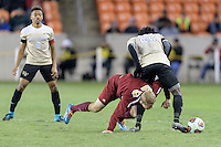 Houston, TX - Friday December 9, 2016: Chandler Crosswait (20) of the Denver Pioneers battles for the ball against Ema Twumasi (22) of the Wake Forest Demon Deacons at the NCAA Men's Soccer Semifinals at BBVA Compass Stadium in Houston Texas.