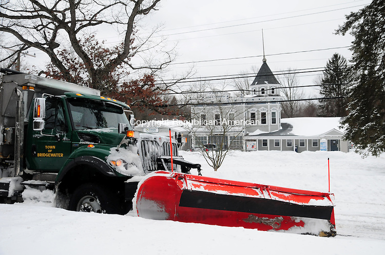 BRIDGEWATER CT, 09 FEB 13-020913AJ01-   A town of Bridgewater plow truck is parked Saturday morning in the center of town as its drivers Woody Banko and Greg Case stopped at the Village Store for a coffee after plowing all night.  Alec Johnson/ Republican-American