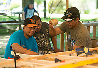 NWA Democrat-Gazette/BEN GOFF @NWABENGOFF<br /> Work continues on the Marshallese KorKor Wednesday, May 9, 2018, at the Shiloh Museum of Ozark History in Springdale. Master canoe builder Liton Beasa and his family, in partnership with the Shiloh Museum of Ozark History, began building the two-man Marshallese canoe called a KorKor April 14 and plan to display the finished canoe at the Little Craft Show Saturday in downtown Springdale.
