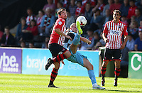 Stephen McGinn of Wycombe Wanderers battles for the ball with Matt Oakley of Exeter City during the Sky Bet League 2 match between Exeter City and Wycombe Wanderers at St James' Park, Exeter, England on 26 September 2015. Photo by Pinnacle Photo Agency.