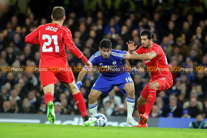 Chelsea's Diego Costa shields the ball from Liverpool's Emre Can - Chelsea vs Liverpool - Capital One Cup Semi-Final Second Leg Football at the Stamford Bridge, London - 27/01/15 - MANDATORY CREDIT: Paul Dennis/TGSPHOTO - Self billing applies where appropriate - contact@tgsphoto.co.uk - NO UNPAID USE