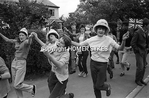 Belfast Orange Day Parade,  teen girls dancing through the street with Union Jack flags. 1970<br />