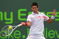 Novak DJOKOVIC (SRB) aganst Olivier ROCHUS (BEL) in the second round of the men's singles. Rochus beat Djokovic 6-2 6-7 6-4..International Tennis - 2010 ATP World Tour - Sony Ericsson Open - Crandon Park Tennis Center - Key Biscayne - Miami - Florida - USA - Fri 26 Mar 2010..© Frey - Amn Images, Level 1, Barry House, 20-22 Worple Road, London, SW19 4DH, UK .Tel - +44 20 8947 0100.Fax -+44 20 8947 0117