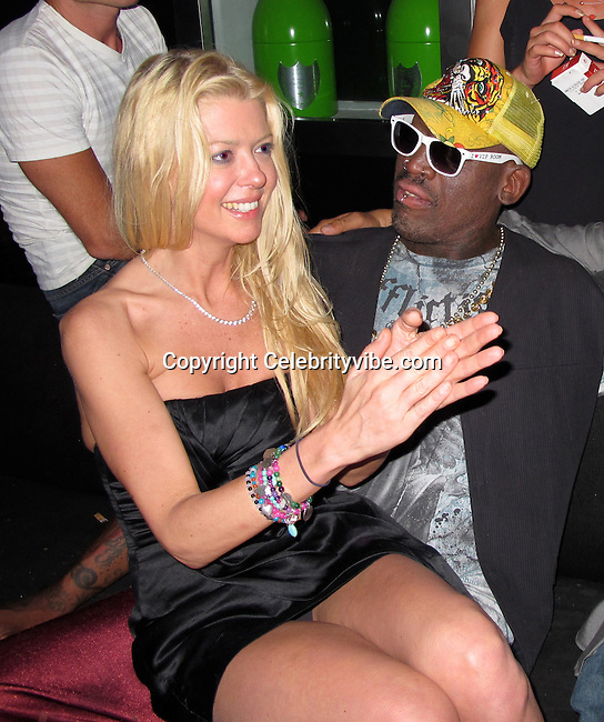 **EXCLUSIVE**.Tara Reid, Dennis Rodman..VIP Room Nightclub..St. Tropez, France..Thursday, July 29, 2010..Photo By iSnaper.com/ CelebrityVibe.com.To license this image please call (212) 410 5354; or Email: CelebrityVibe@gmail.com ; .website: www.CelebrityVibe.com.