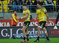 Hurricanes' Beauden Barrett (left) and Hurricanes' Isaia Walker-Leawere react at the final whistle of the Super Rugby quarterfinal between the Hurricanes and Bulls at Westpac Stadium in Wellington, New Zealand on Saturday, 22 June 2019. Photo: Dave Lintott / lintottphoto.co.nz