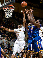 Emerson Murray of California fights for a loose ball during the game against SJSU at Haas Pavilion in Berkeley, California on December 7th, 2011.   California defeated San Jose State, 81-62.