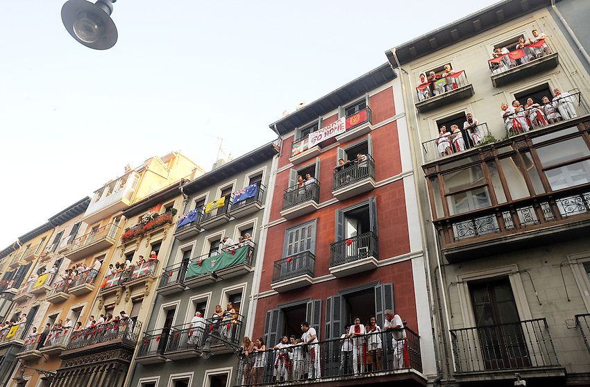 People wait the beginning of the third running of the bulls of San Fermin Festival, on July 9, 2013, in Pamplona, Basque Country. On each day of the eight San Fermin festival days six bulls are released at 8:00 a.m. (0600 GMT) to run from their corral through the narrow, cobbled streets of the old navarre town over an 850-meter (yard) course. Ahead of them are the runners, who try to stay close to the bulls without falling over or being gored. (Ander Gillenea / Bostok Photo)