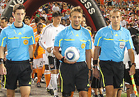 Referee Alex Prus and associates enter the field  during an MLS match between D.C. United and the Houston Dynamo at RFK Stadium in Washington D.C. on September  25 2010. Houston won 3-1.