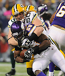 Green Bay Packers linebacker A.J. Hawk, top, stops Minnesota Vikings running back Adrian Peterson for a negative gain during the first quarter of the game at the Hubert H. Humphrey Metrodome in Minneapolis, Minn. on Nov. 21, 2010.
