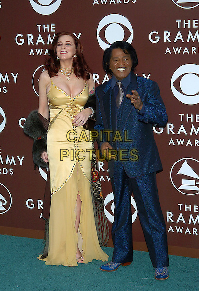 TOMMIE RAE & JAMES BROWN .47th Annual Grammy Awards - Arrivals. Los Angeles, California .February 13th, 2005.Photo Credit: Jacqui Wong/AdMedia.full length married husband wife blue sparkly shiny shimmering suit yellow gold dress silk satin.www.capitalpictures.com.sales@capitalpictures.com.© Capital Pictures.