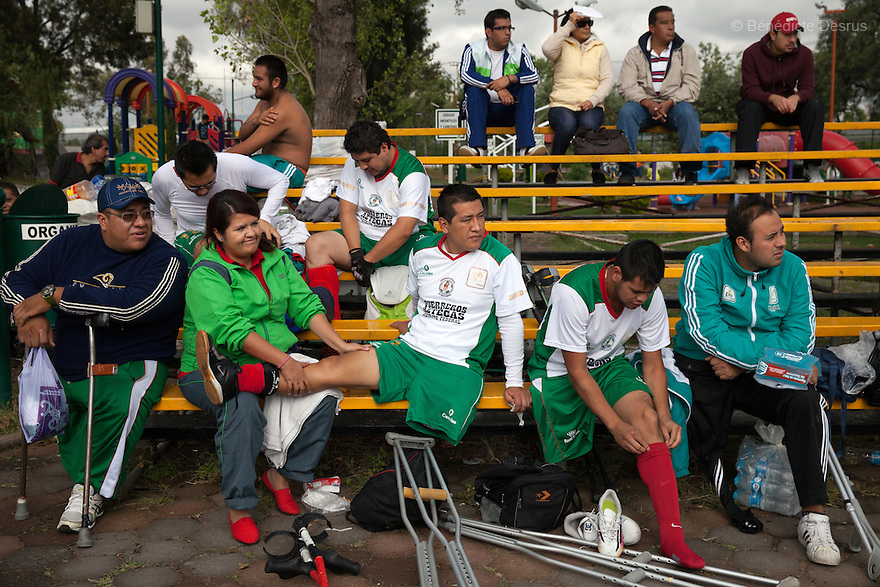 """Players from Guerreros Aztecas get a massage and get changed before a soccer game against Los Dragones (""""the Dragons"""")  in Deportivo Tlalli II in Talnepantla, Mexico on September 27, 2014. Guerreros Aztecas (""""Aztec Warriors"""") is Mexico City's first amputee football team. Founded in July 2013 by five volunteers, they now have 23 players, seven of them have made the national team's shortlist to represent Mexico at this year's Amputee Soccer World Cup in Sinaloathis December.The team trains twice a week for weekend games with other teams. No prostheses are used, so field players missing a lower extremity can only play using crutches. Those missing an upper extremity play as goalkeepers. The teams play six per side with unlimited substitutions. Each half lasts 25 minutes. The causes of the amputations range from accidents to medical interventions – none of which have stopped the Guerreros Aztecas from continuing to play. The players' age, backgrounds and professions cover the full sweep of Mexican society, and they are united by the will to keep their heads held high in a country where discrimination against the disabled remains widespread.(Photo byBénédicte Desrus)"""